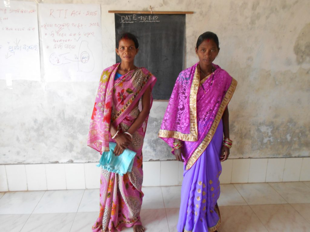 Two young women who had just got their opinions heard in a village meeting.