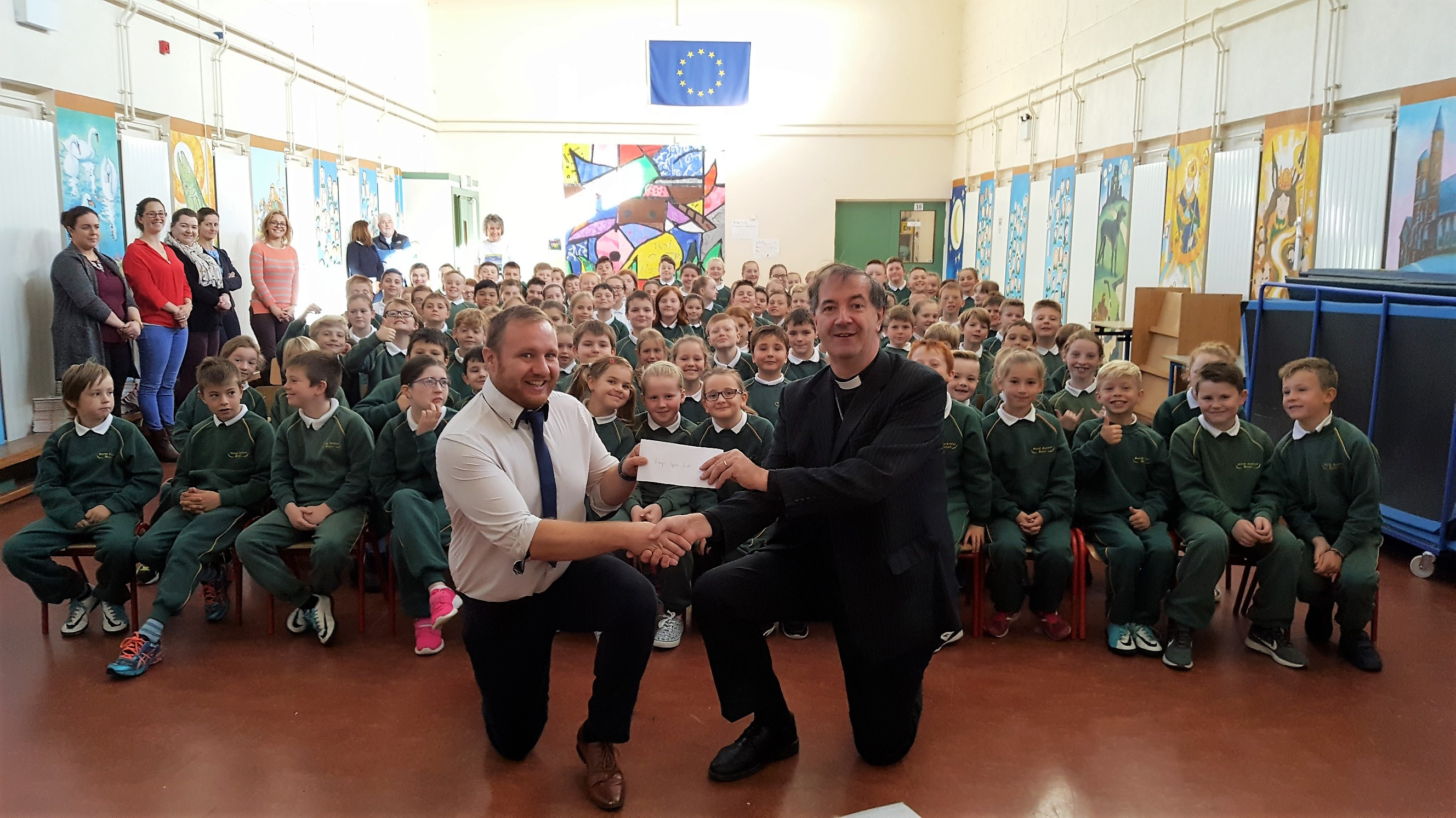 Route 66 - Bishop Burrows receives cheque from Principal in Gorey school