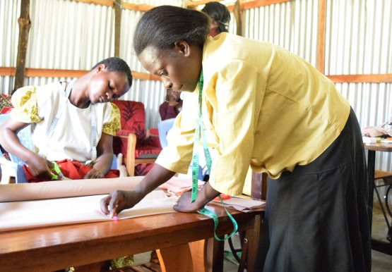 One of the project participants learning tailoring skills