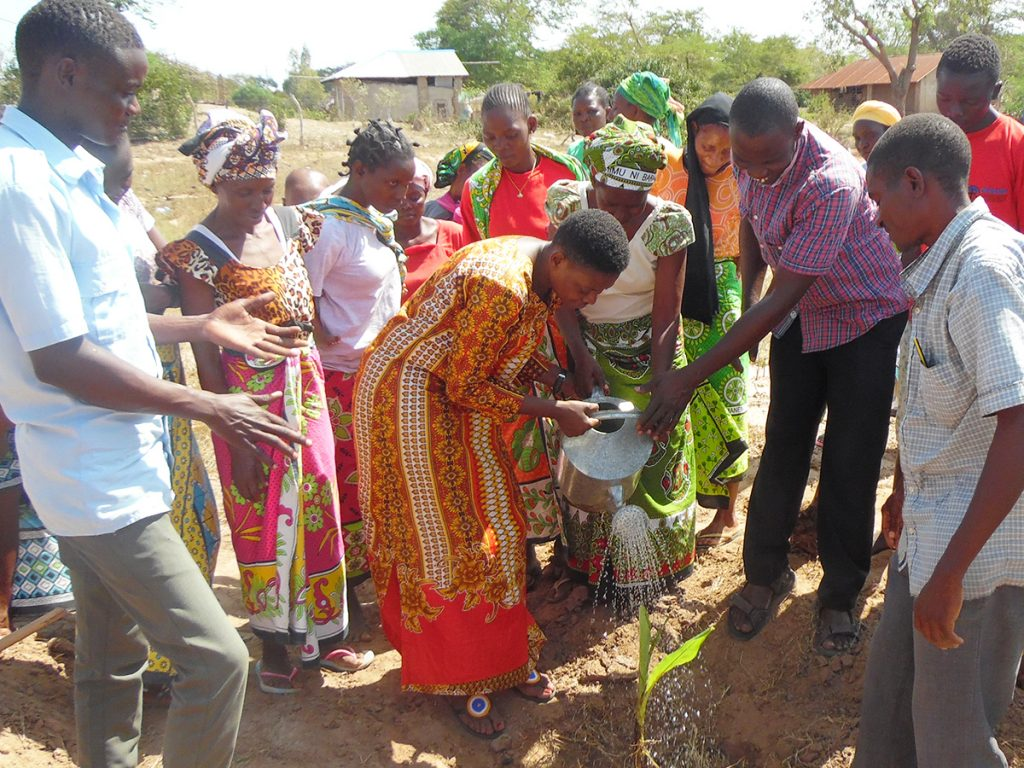 Some of the community members supported through our project, watering a vegetable patch